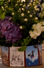 flowers in container with images of Mary Poppins